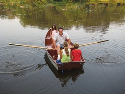 Flat Skiff 12 with four people aboard