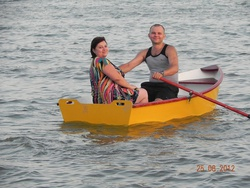 Two people aboard Dixi Dinghy