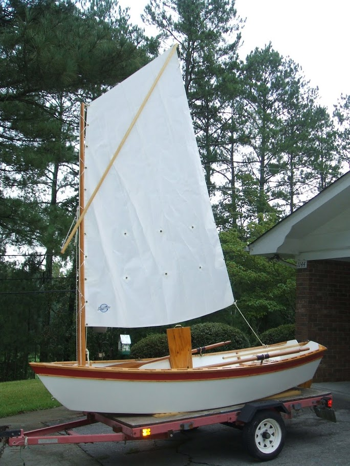 Semi Dory 11. [SD11] Flat bottom dory type dinghy. Oars, sail or outboard