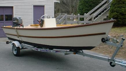 Wee Hunk. A 16' stitch and glue power dory with center console